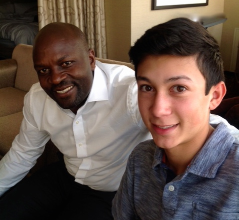 Nicolas, CEO of One Pencil Per Child with mentor and CNN Hero, Jackson Kaguri